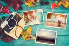 Photo album in remembrance and nostalgia in autumn fall season on wood table. Instant photo of retro camera - vintage and retro style Royalty Free Stock Images