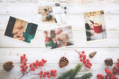 Photo album in remembrance and nostalgia in Christmas winter season on wood table. Photo of retro camera - vintage and retro style, top view Royalty Free Stock Photography
