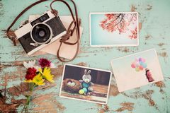 Photo album in remembrance and nostalgia of Happy easter. Day in spring on wood table. instant photo of vintage camera - vintage and retro style Royalty Free Stock Photography