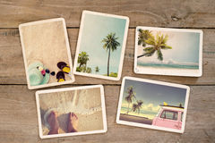 Photo album remembrance and nostalgia journey in summer surfing beach trip on wood table. Instant photo of vintage camera - vintage and retro style stock photos