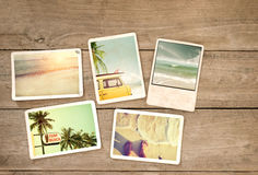 Photo album remembrance and nostalgia journey in summer surfing beach trip on wood table. Instant photo of vintage camera - vintage and retro style Stock Photo