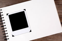 Photo album with one blank polaroid photo frame, copy space royalty free stock images