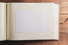 Photo album on wooden desk Stock Image