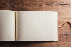 Photo album on wooden desk Royalty Free Stock Image