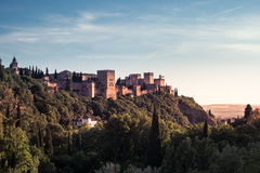 Photo of Alhambra in Granada, Spain. Beautiful sunset view of Spain`s main tourist attraction, ancient arabic fortress of Alhambra, Granada, Spain stock photo