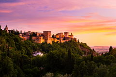 Photo of Alhambra in Granada, Spain. Beautiful sunset view of Spain`s main tourist attraction, ancient arabic fortress of Alhambra, Granada, Spain royalty free stock photo