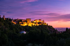 Photo of Alhambra in Granada, Spain. Beautiful sunset view of Spain`s main tourist attraction, ancient arabic fortress of Alhambra, Granada, Spain stock photos