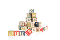 Photo of a alphabet blocks spelling kids isolate on white backgr Stock Images