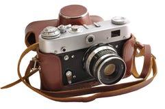 Photo-appareil-photo utilisé d'isolement de film dans le cas en cuir Photographie stock libre de droits