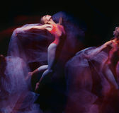Photo as art - a sensual and emotional dance of. Beautiful ballerina through the veil on a dark background royalty free stock photos