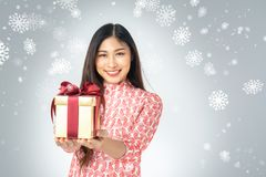 Photo of asian curious woman in red dress enjoy new year gift bo stock image