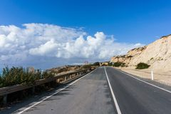 Photo of asphalt road near mountain. Against cloudy sky background Royalty Free Stock Photography