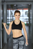 Photo of athletic young girl standing with dumbbells stock image