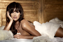 Photo of attractive brunette lady lying in bed looking at camera Royalty Free Stock Photo