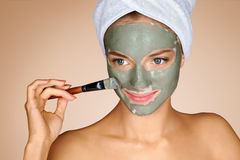 Photo of attractive young woman receiving spa treatments stock images