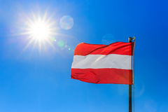 Austrian flag and clear blue sky. Photo of Austrian flag and sunny clear blue sky Royalty Free Stock Photography