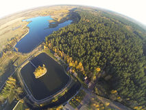 Photo of an autumn lake in forest with a bird's eye view Royalty Free Stock Photos