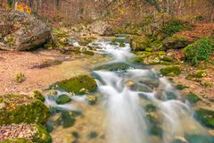Photo of autumn in the mountains landscape of the river and stones. In the canyon stock photos