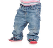 Photo of a baby standing waist down Stock Images