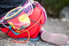 Photo from back of rock climber with backpack and bag with talp near mountain. On summer day stock images