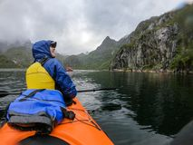 Photo from back of woman tourist with paddle canoe floating along river stock photo
