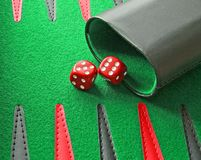 Backgammon rolling dice and shaker royalty free stock image