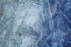 Photo background frozen ice. Photo background bright blue frosted thin ice with cracks in the spring Royalty Free Stock Photography