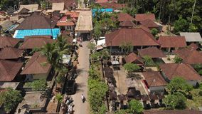 Aerial photo of balinese houses during the big celebration. Bali ceremony in village, Ubud. Roofs of balinese houses. stock photo