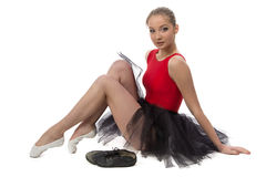 Photo of ballerina sitting on the floor royalty free stock image
