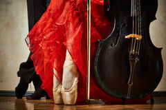 Photo of ballet pointe and latin dancers shoes and cello. Close up photo of ballet pointe and latin dancers shoes and cello stock photography