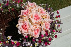 Photo of basket with pink rose flowers Royalty Free Stock Images
