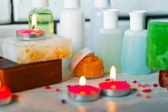Photo of bathrooms, spa treatments. Transparent bottles, loofah, pieces of soap, bath salts, candles. Comfort. And relaxation stock photos