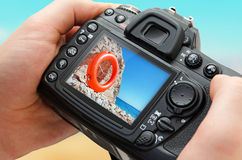 Photo of beach on camera display during the summer vacation. Stock Photography