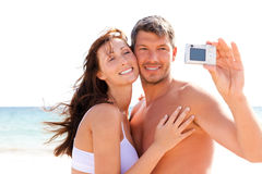 Photo beach couple Stock Images