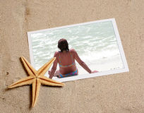 Photo in beach sand with starfish Stock Photo