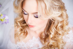 Photo of a beautiful blonde bride in a luxurious wedding dress in interior Royalty Free Stock Image