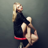 Photo of beautiful blonde woman in black dress. Fashion photo royalty free stock photography