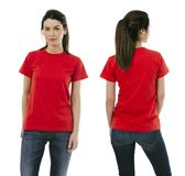 Brunette woman wearing blank red shirt. Photo of a beautiful brunette woman posing with a blank red t-shirt, ready for your artwork or design Royalty Free Stock Photo