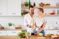 Photo of beautiful couple in love preparing breakfast in kitchen royalty free stock photo