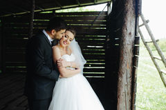 Photo of beautiful couple on nature in wooden hut Stock Photos