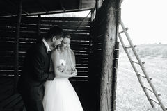 Photo of beautiful couple on nature in wooden hut Stock Photo