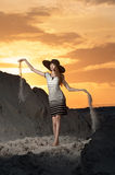 Photo beautiful girl on the beach. Photo of a girl in a short evening dress standing on sand at the beach stock photos