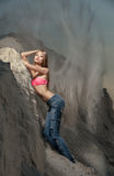 Photo beautiful girl on the beach. Standing in jeans with sand stock photography