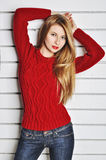 A photo of beautiful girl is in fashion style, glamour. Red sweater. Royalty Free Stock Images