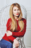 A photo of beautiful girl is in fashion style, glamour. Red sweater. Stock Photography