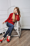 A photo of beautiful girl is in fashion style, glamour. Red sweater. stock photos