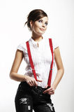 Photo of beautiful girl stretching suspenders Stock Photos