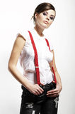 Photo of beautiful girl stretching suspenders royalty free stock image
