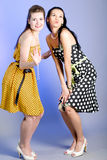 Photo of beautiful girls. Two young beautiful girls in elegant dresses royalty free stock photo