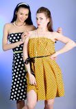 Photo of beautiful girls. Two young beautiful girls in elegant dresses stock photo